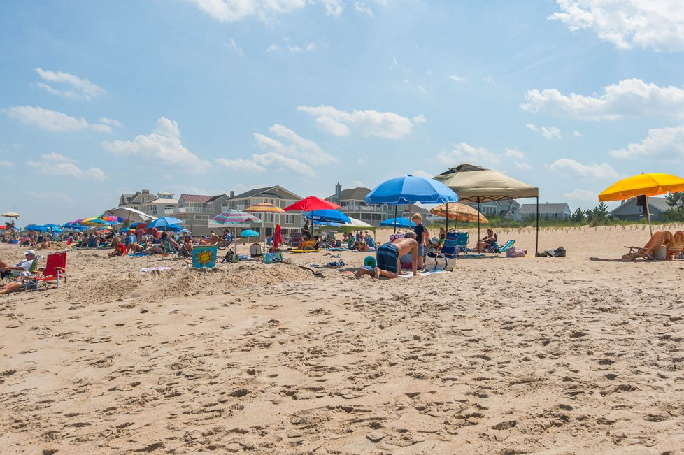 people on the beach in dewey beach de
