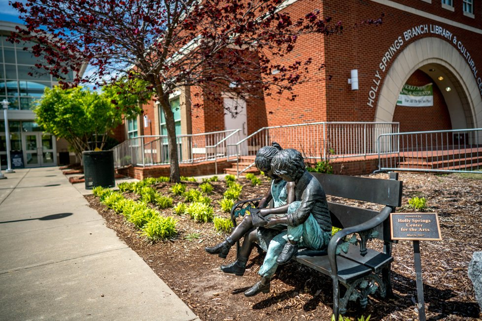 sculpture in front of holly springs nc library
