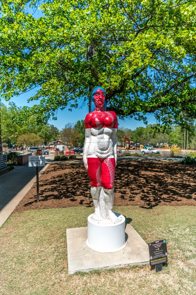 red and white statue cary nc