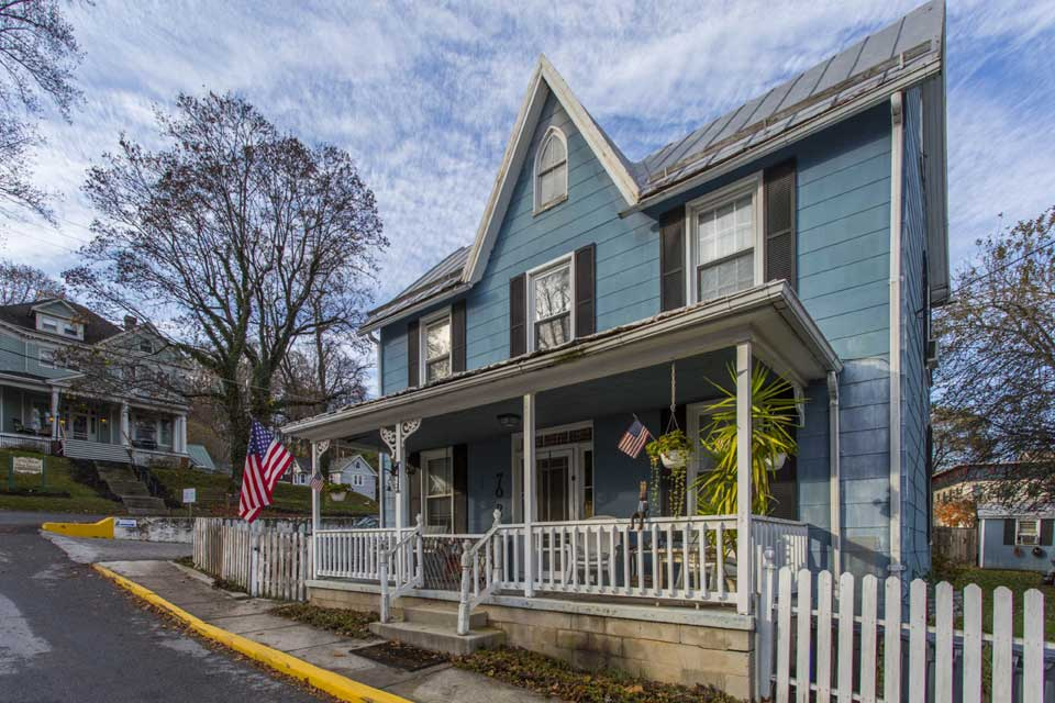 blue single family home in Sykesville, MD
