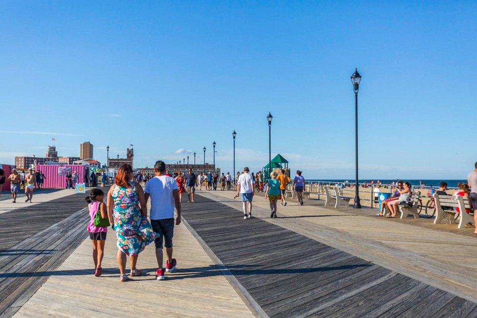 People Walking On Boardwalk In Asbury Park Nj