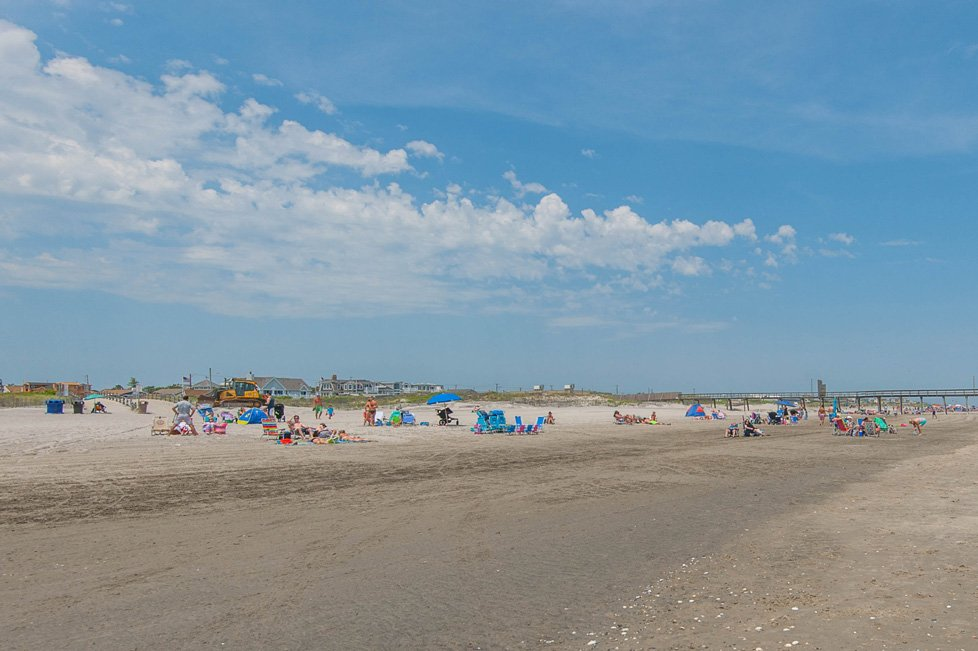 people on the beach in avalon nj