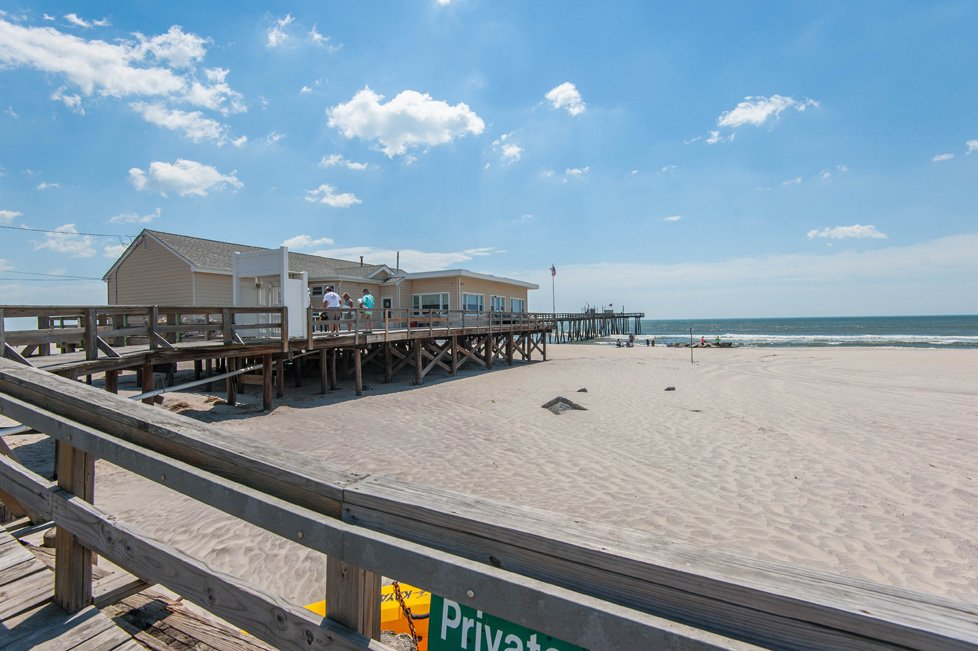 dock leading to beach margate city nj