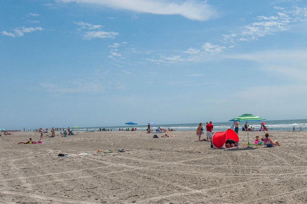 people on the beach in wildwood nj