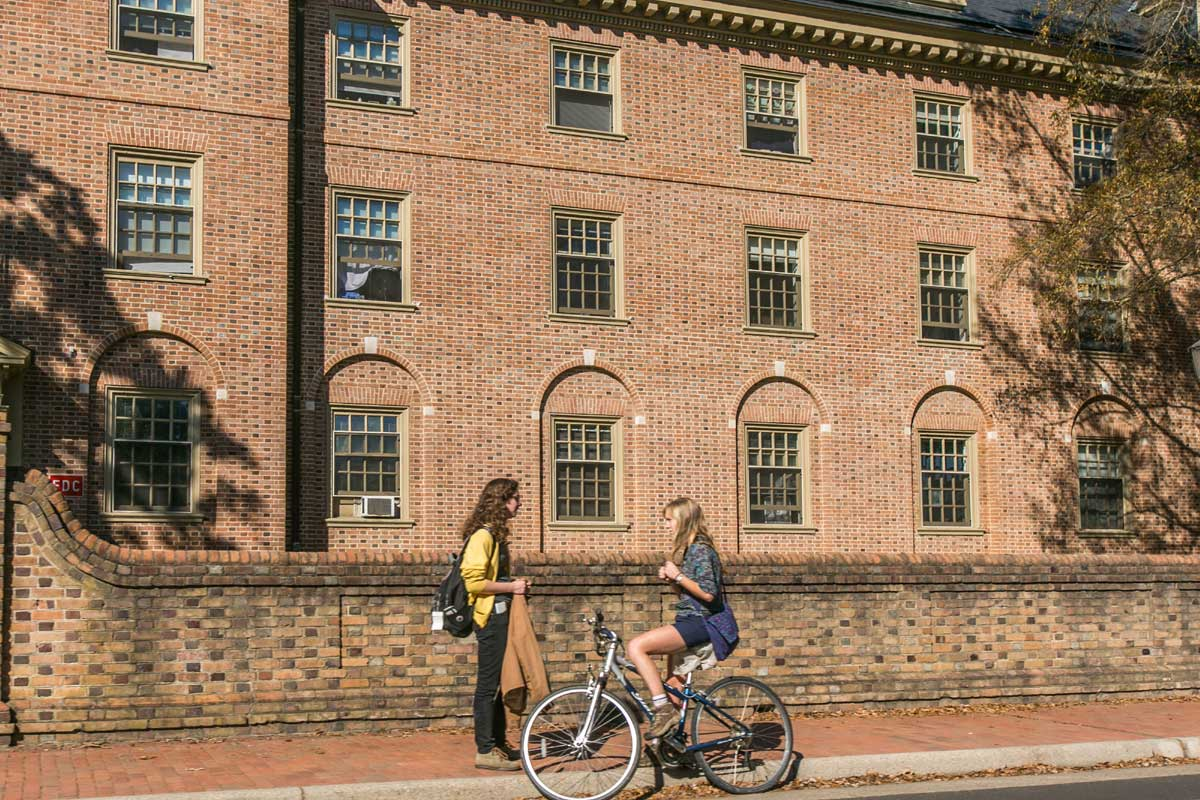Woman talking to another woman on a bicycle in Williamsburg, VA