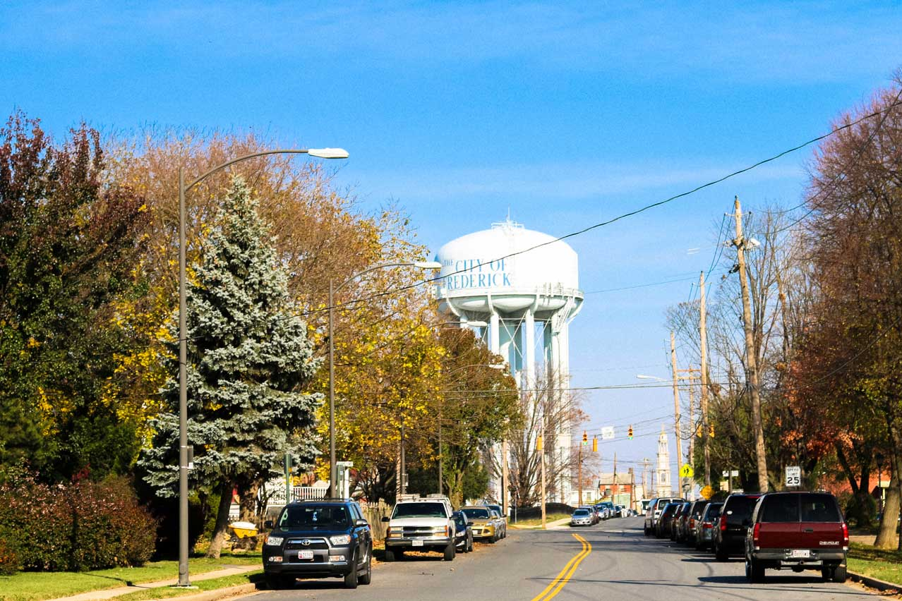 Street with city of Frederick water tower in Frederick, MD