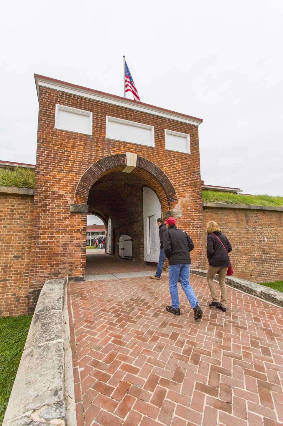People walking in to Ft McHenry in Locust Point, Baltimore, MD
