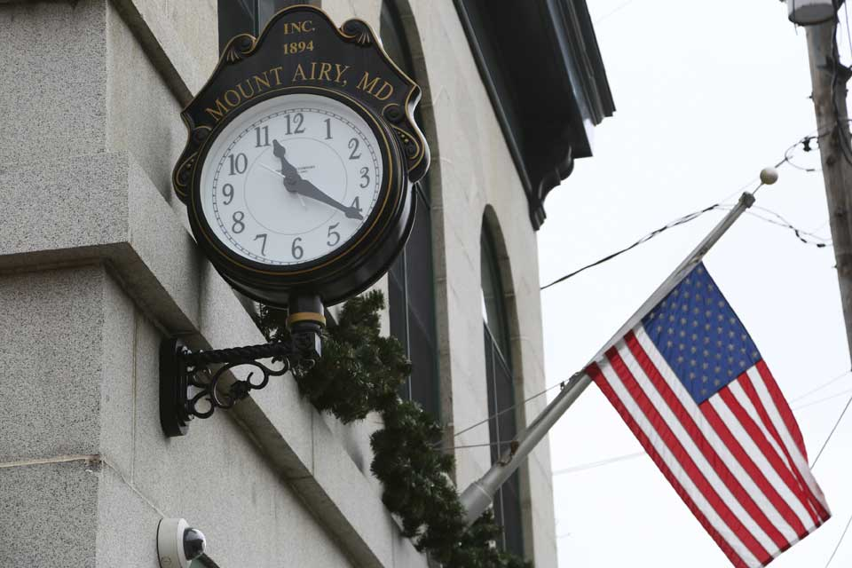 Clock and american flag in Mount Airy, MD
