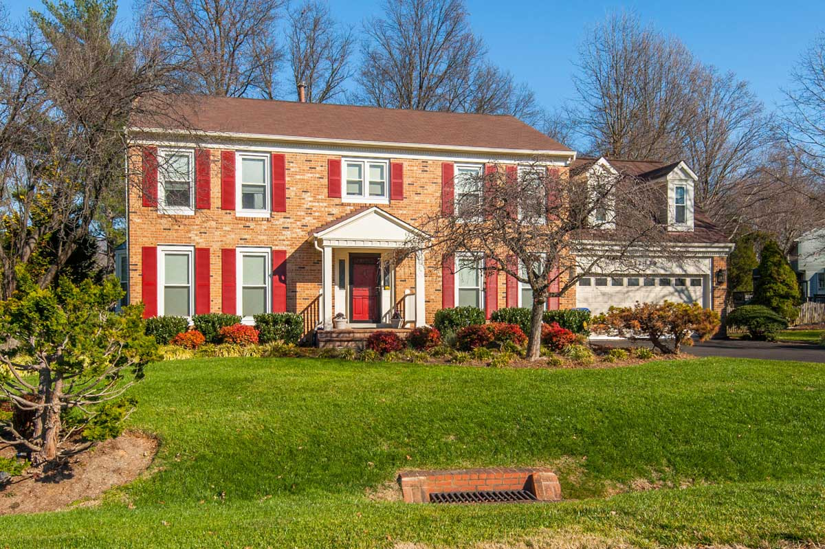 Brick single family home red shutters in Olney, MD