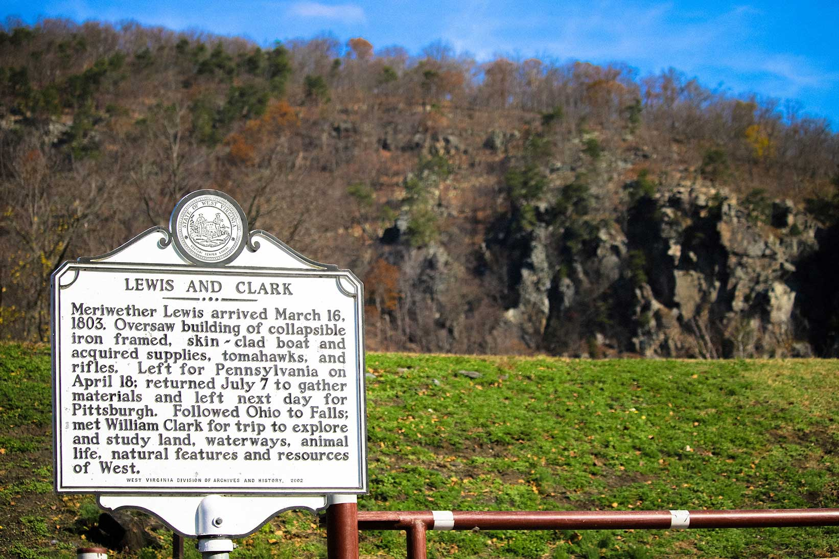 Lewis & Clark historical marker with mountains in background in Harper's Ferry, WV