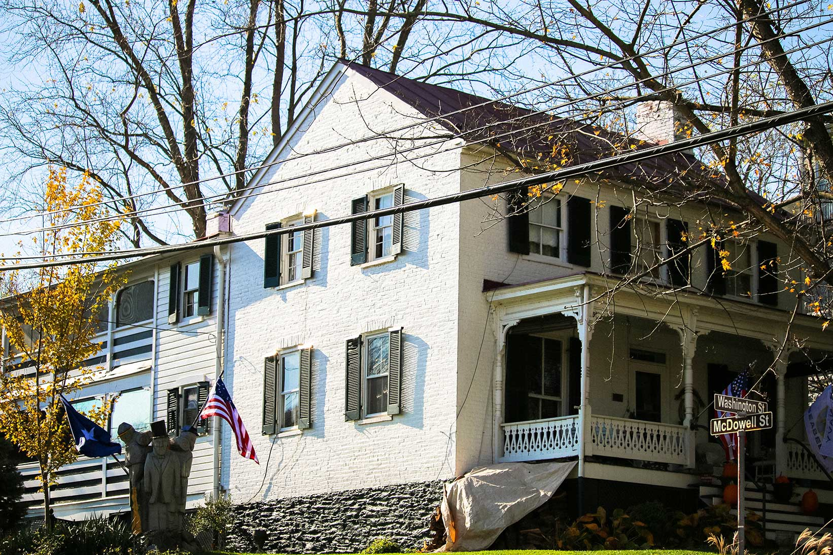 White single family home with statue in Harper's Ferry, WV