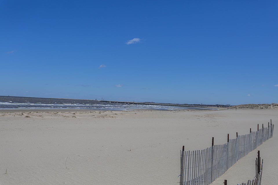 Beach with fence in Lewes, DE